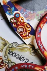 dolce-and-gabbana-eyewear-special-edition-hand-made-sicilian-carretto-sunglasses-Portrait-03-373x560